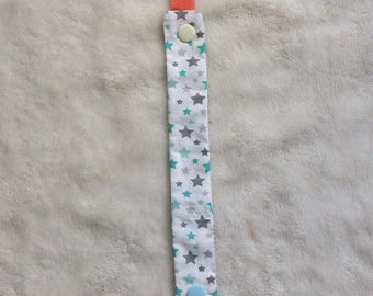 Attached fabric pacifier