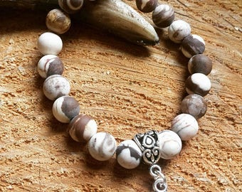 Cappuccino Jasper (frosted) with Ohm symbol.