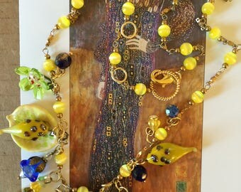 "24"" yellow bead necklace with lamp work beads"