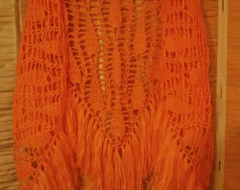 Peach-colored crocheted exclusive shawl with long tassels