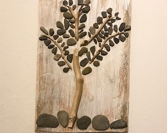 Tree with river stones and wood