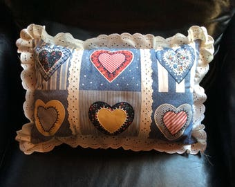 Denim pillow with eyelet trim