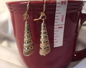 gold colored sea shell