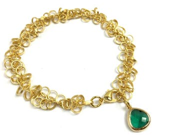 Gold plated bracelet with emerald crystal charm