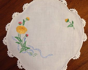Vintage hand embroidered doily, 22cm round, yellow rose and blue bow