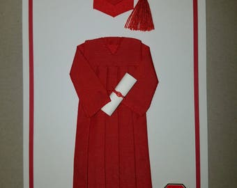 Red cap and gown graduation card.