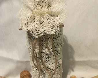 Lace and twine wrapped wine bottle