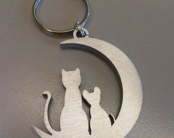 Cat and mouse sitting on Moon aluminium keychain