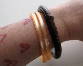 vintage bangle bracelets . peachy moonglow and brown bangle, molded hard plastic jewelry