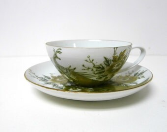 Fujita Kutani Japan. 1940s green and gold peacock pattern . handpainted teacup and saucer set