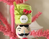 no. 43 christmas nutcracker spool head ornament