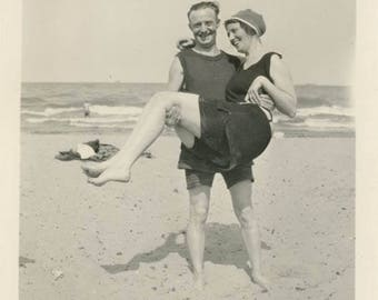 vintage photo Man Carrying Bathing Beauty at the Beach 1923