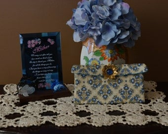 Soft cream and blue eye popping I Phone pocket with brooch