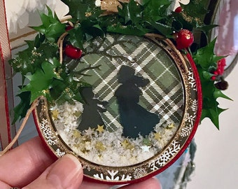 one handmade doublesided Christmas shaker ornament with ice skaters santa in sleigh