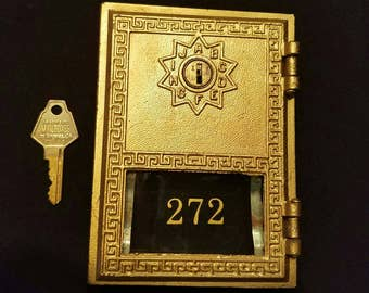 Post office box door with key