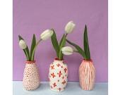 Trio of ceramic vases in red pattern
