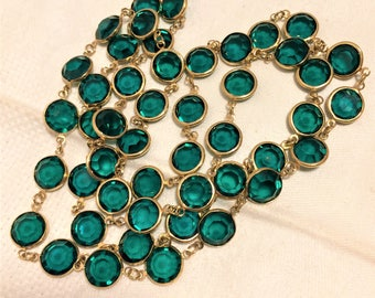 Vintage Deep Green Crystal Necklace that is 34 Inches Long. It is not Marked But Looks Like a Swarovski Crystal Necklace. Flat Crystals D13