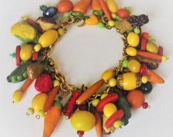Bits & Pieces Cha Cha Charm Bracelet by Nancy