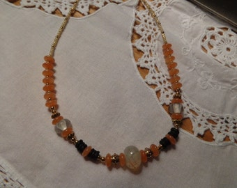 Peach and gold beaded necklace