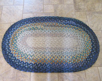 Vintage oval hand braided rug in blue and other colors- good used condition, ready to add to your home decor