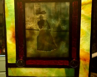 Stained Glass Window Featuring Antique Image of a Ghostly Victorian Woman Holding a Cat