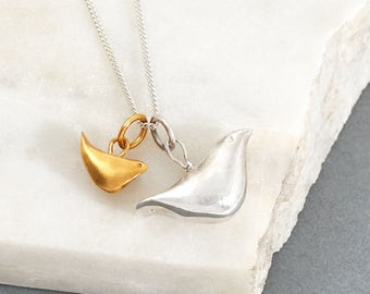 Mother and baby bird gold and silver necklace