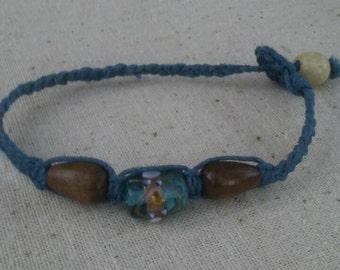 Blue Magic lampwork glass bracelet on dusty blue hemp