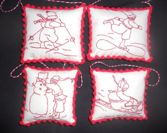 Set of four red work ornaments, snow scene red work ornaments