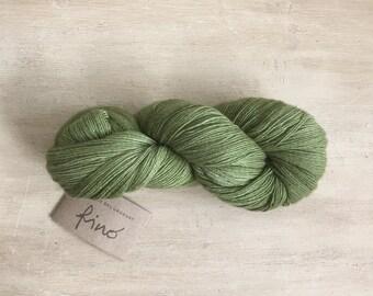 Manos Del Uruguay Fino / merino silk blend / non - profit and fair trade / 1 ply / forest green