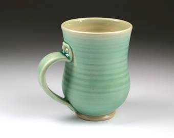 Wheel thrown aqua blue pottery mug with screw hardware on handle