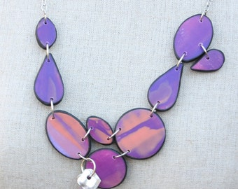 Handmade, shades of purple, abstract design polymer clay necklace
