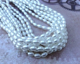 free uk postage Strand of 80 Faux Pearl Beads Rice Glass Pearls White