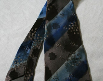 1960s brown and blue diagonal stripe acetate necktie with dot and splotch damask