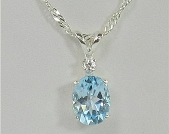 Sky Blue Topaz 9x7mm 2.25ct White Zircon Accent Sterling Silver Pendant Necklace