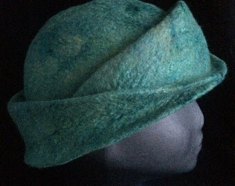 Merino wool and silk sliver, wet felted into a hand sculpted cloche style hat