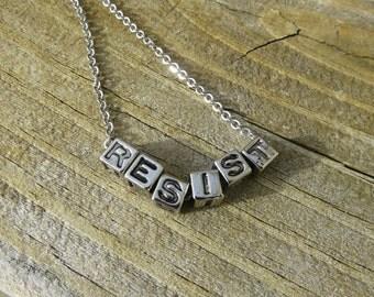 RESIST Necklace (acrylic silvertone)