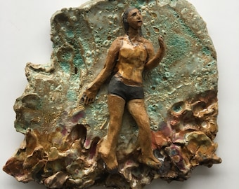 Ceramic art wall tile relief figure sculpture glaze painting wabi sabi woman in the sky, dancer in shorts, tank top
