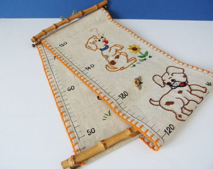 Vintage handmade embroidered wall height chart.