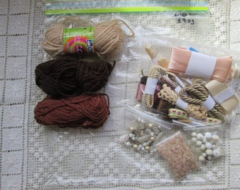 Beige and brown small grab bag of sewing notions (USA) haberdashery (UK)