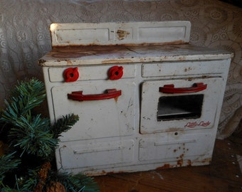Toy Stove Metal Little Lady Red and White Rusty Vintage at Quilted Nest
