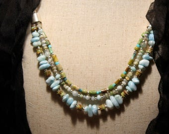Triple strand of turquoise, larimar, peruvian opal, gaspiete and blue quartz, bib design on sterling silver by EvyDaywear