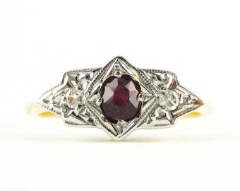 Art Deco Ruby & Diamond Engagement Ring, Three Stone Ring with Oval Cut Dark Red Ruby in Geometric Shape. Circa 1930s, 18ct Plat.