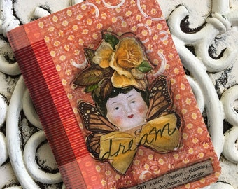 Frozen Charlotte Head Mini Composition Journal Dream Yellow Flowers and Orange Pattern Background