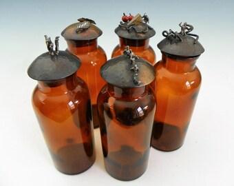 5 glass jars with handmade lids