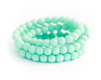 WE'RE BACK! Mint Druk Beads, Pastel Green Pressed Opaque Czech Glass, Smooth Round Spacer Beads, 4mm x 50pc (0012)