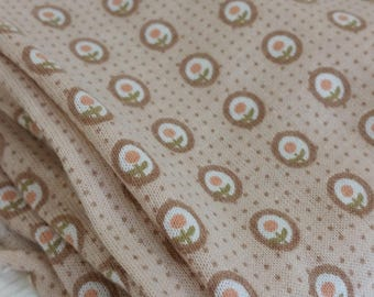Cameos of peach lollipop flowers on beige background  knit fabric vintage