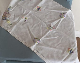 A small vintage hand embroidered tray cloth.