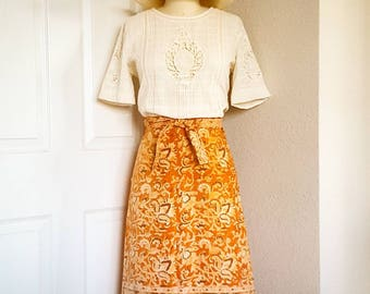 orange burnt sienna rust 'papago' cotton wrap skirt with border hem, side patch pockets and waist tie with buttonhole