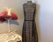 Lacy Black Over Cream Drop Waist Dress With Black Ribbon