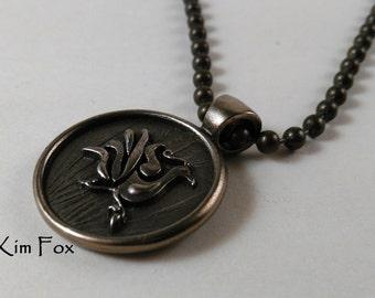 This Chinese Phoenix Pendant in Bronze